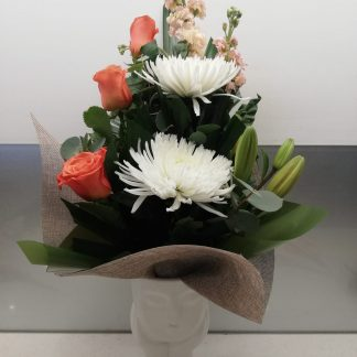 Beautiful arrangement is a day dreaming lady vase